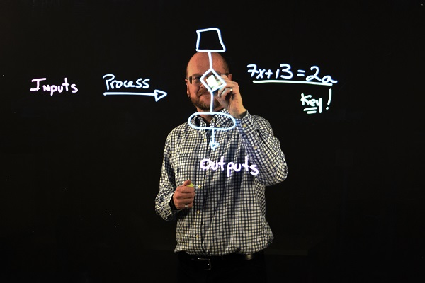 [Eric Tremblay shows how the lightboard works] (Photo: PPS)