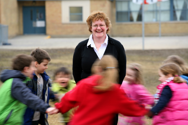Wendy Craig, Queen's Head of Psychology on the playground with children.