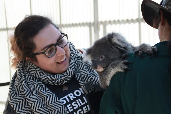 Katrina Brown Akootchook is introduced to local culture hands-on as she meets a koala during the trip to Australia. (Supplied Photo)