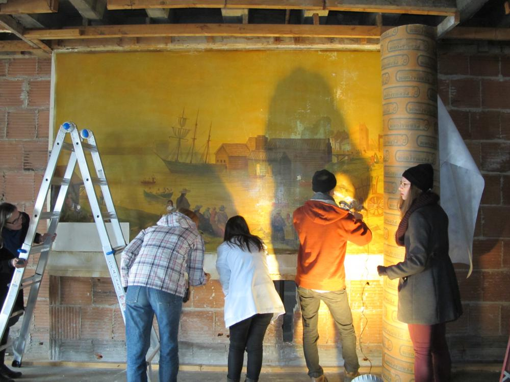 Masters of Art Conservation students work to prepare a mural by Kenneth Hensley Holmden (1893-1963) for removal from 16 Bath Rd.