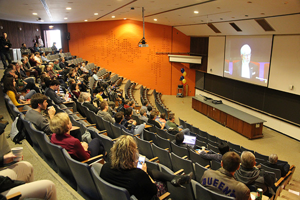 Members of the Queen's community gather at Stirling Hall to watch the livestream of Art McDonald (Physics, Engineering Physics and Astronomy) receiving the Nobel Prize in Physics.
