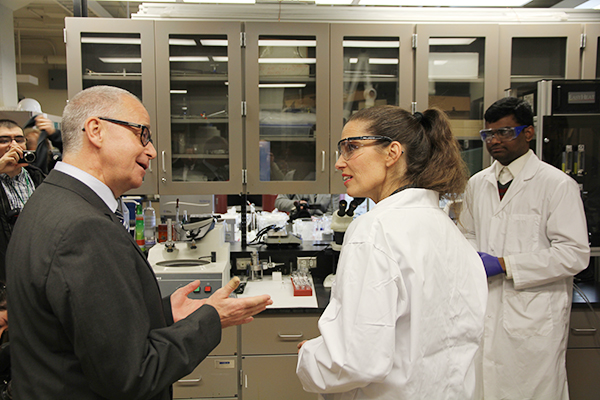 Gregory Jerkiewicz (Chemistry) speaks to Minister of Science Kirsty Duncan during a tour of his lab at Queen's University's Chernoff Hall. Minister Duncan helped announce a $4-million grant from Natural Sciences and Engineering Research Council of Canada.