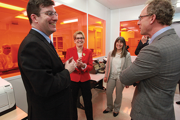 Premier Kathleen Wynne speaks with representatives and researchers of Kingston Nano Fabrication Laboratory during her tour Thursday of Innovation Park.
