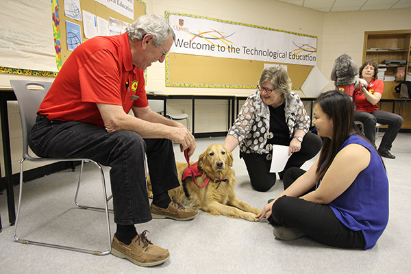 Rebecca Luce-Kapler, Dean of the Faculty of Education, joins in the pet therapy during the Revive & Thrive event hosted at Duncan McArthur Hall on Wednesday.