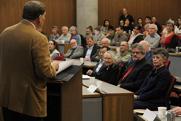Prizes for Excellence in Research recipients, from left, Guojun Liu (Chemistry), Jacalyn Duffin (History of Medicine), Mark Diederichs (Geological Sciences and Geological Engineering) and Anne Croy (Biomedical and Molecular Sciences), listen as Principal Daniel Woolf speaks at the beginning of the public lecture event.