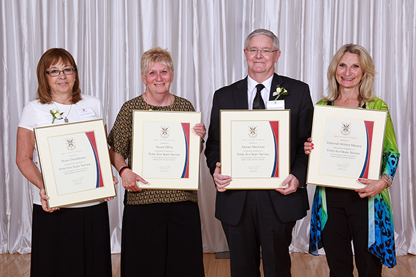 Four members of the Queen's community are marking 45 years of continuous service, from left: Diane Dumbleton; Susan Office; Alistair MacLean and Deborah Stirton-Massey. (Photo by Bernard Clark)