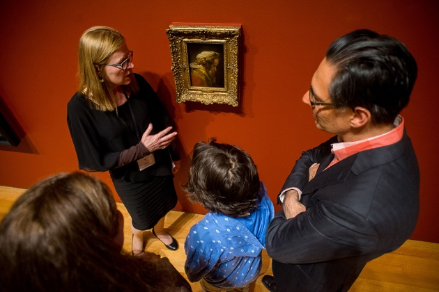 [Jan Allen talks with visitors to the gallery]