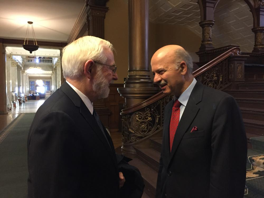 Dr. Art McDonald is greeted at Queen's Park by the Honourable Reza Moridi, Minister of Research and Innovation and Minister of Training, Colleges and Universities, on June 9. (Photo by University Communications)