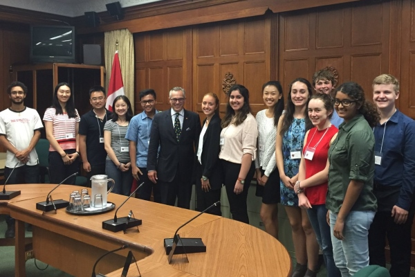 [Tony Clement with students]