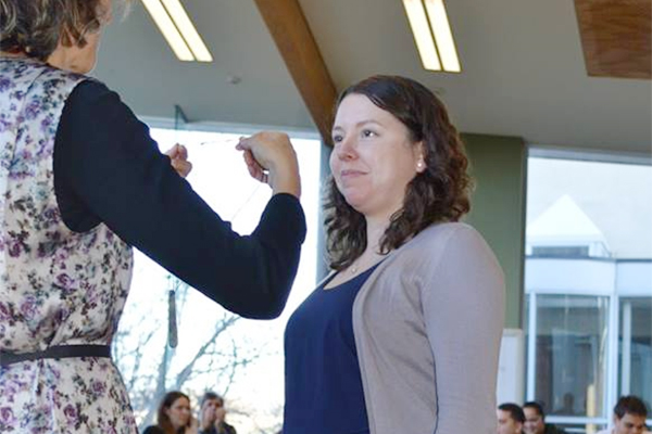 Queen's graduate student Shyra Barberstock receives a gift of pounamu (greenstone) at the farewell event for the Matariki Network Indigenous Student Mobility Program. (University of Otago)