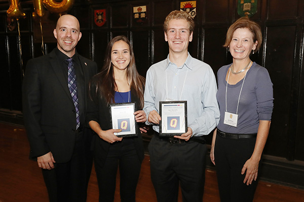 Provost and Vice-Principal (Academic) Benoit-Antoine Bacon, left, and Ann Tierney, Vice-Provost and Dean of Student Affairs, present Nixon Academic Leadership Awards to Taylor Sills and Sam Abernethy. (Photo by Lars Hagberg)