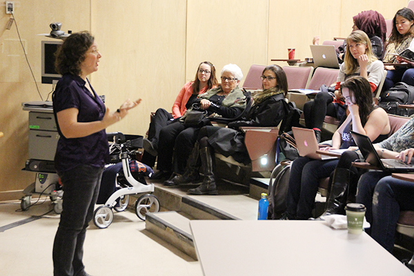 As part of her Queen's University experience, Verna Clancy, front row centre, attended a lecture by Una D'Elia (Art History). Joining her were Sheena Brazeau of Sienna Senior Living, left, and Erika Beresford-Kroeger, Strategic Initiatives Specialist, School of Rehabilitation Therapy.