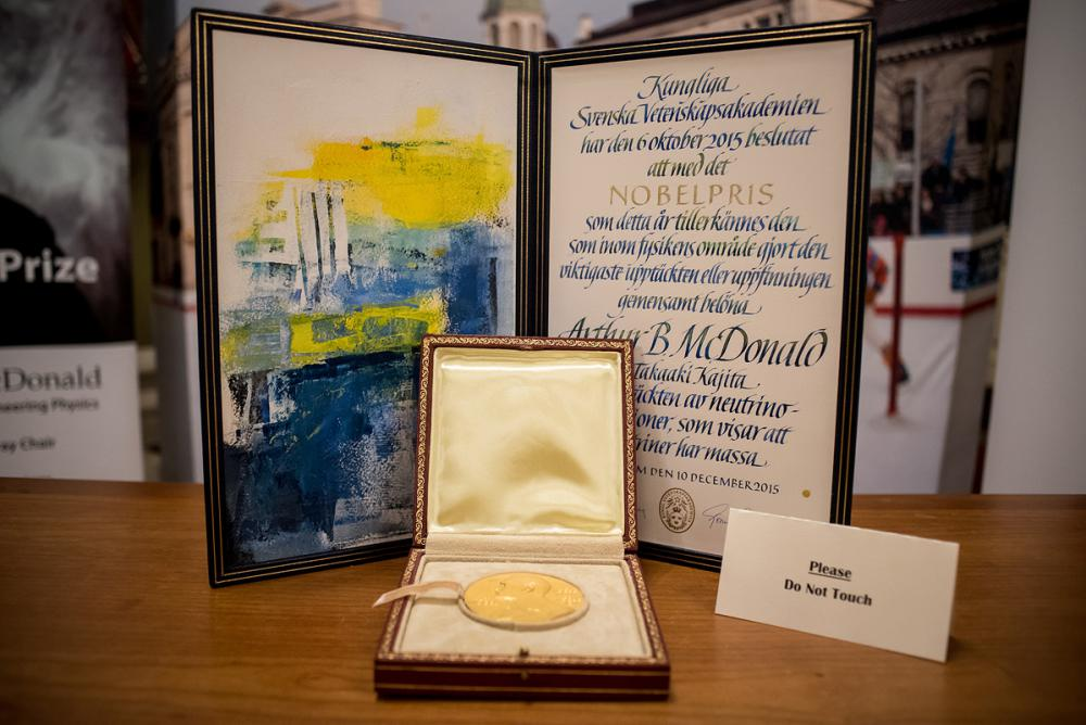 Dr. Art McDonald's Nobel medal and diploma on display during his public lecture on December 7, 2016 at Kingston City Hall. (Photo Credit: Garrett Elliott)