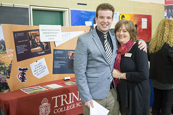 Will Cunningham, ED'16, of Trinity College School, hugs Elspeth Morgan, Career and Recruitment Advisor for the Faculty of Education, at the Options Career Fair.