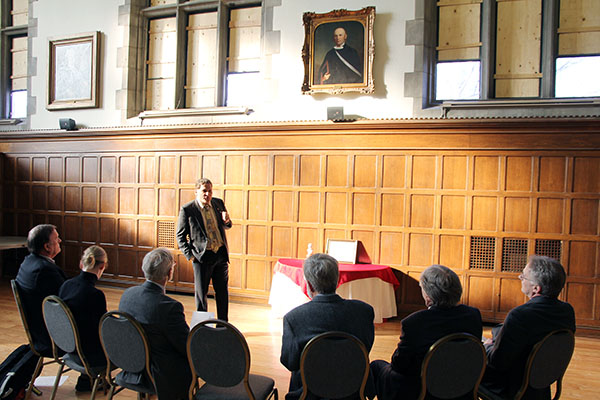 Principal Daniel Woolf speaks to a small gathering in Wallace Hall about the history of his predecessor William Leitch, the fifth principal of Queen's University.