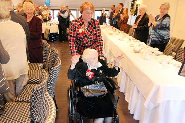 Stephanie Deutsch arrives at her 100th birthday celebration at the University Club along with her daughter Mary Deutsch, on Monday, Jan. 2. (University Communications)