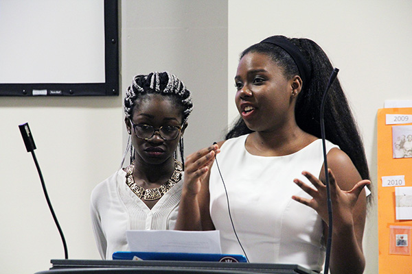 Elorm Vowotor, left, and Shanice Howard, co-presidents of the African and Caribbean Students Association (ACSA), speak during the Black History Month opening ceremony hosted at Robert Sutherland Hall.