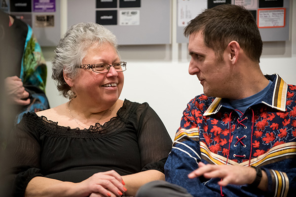 Janice Hill, Director of Four Directions Aboriginal Student Centre, speaks with lecturer Nathan Brinklow during Tuesday's event marking the release of the Queen's Truth and Reconciliation Commission Task Force's final report. (Photo by Garrett Elliott)
