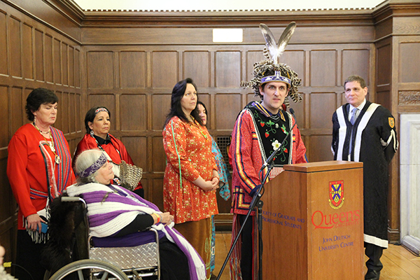 Nathan Brinklow, a lecturer in the Department of Languages, Literatures and Cultures, speaks after presenting Principal Daniel Woolf with a friendship wampum on behalf of the clan mothers at Tyendinaga and the Grandmother's Council in Kingston.