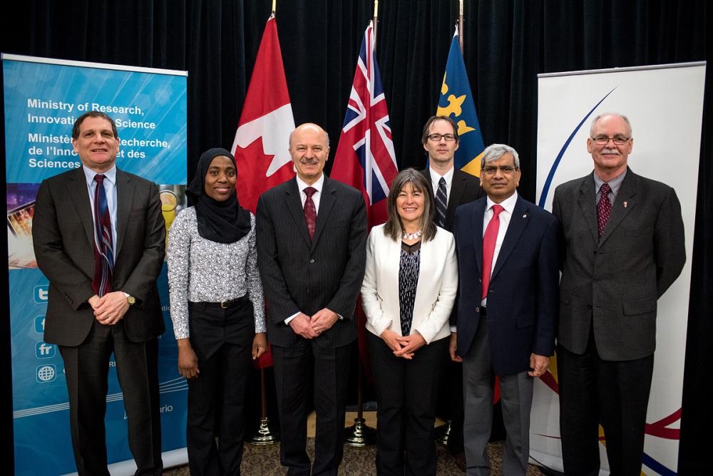 From L-R: Principal Daniel Woolf, Khadijat Hassan, The Honorable Reza Moridi, MPP Sophie Kiwala, Alexander Braun (Geological Sciences and Geological Engineering), Praveen Jain (Electrical and Computer Engineering), and John Fisher, Interim Vice-Principal (Research). (March 14, 2017. Photo Credit: Garrett Elliott)