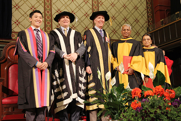 Queen's recognized Gururaj, second from right, and Jaishree Deshpande, right, with honorary degrees. From left are Rector Cameron Yung, Principal Daniel Woolf, and Chancellor Jim Leech.