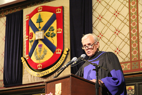 Lawyer and former Gaels quarterback Donald Bayne speaks at Grant Hall on Friday, June 9 after receiving an honorary degree from Queen's University.