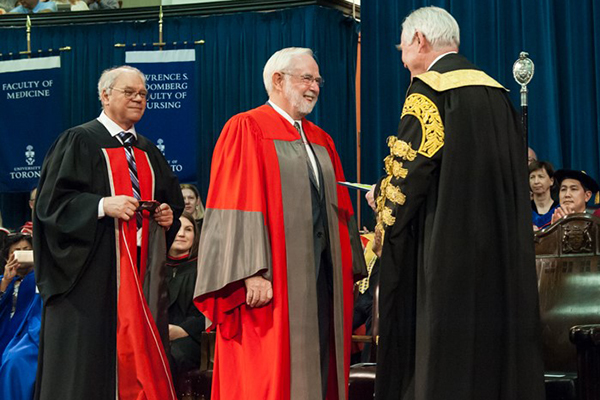 University of Toronto Chancellor Michael Wilson confers an honorary degree upon Arthur McDonald, the winner of the 2015 Nobel Prize in Physics on Thursday, June 8.