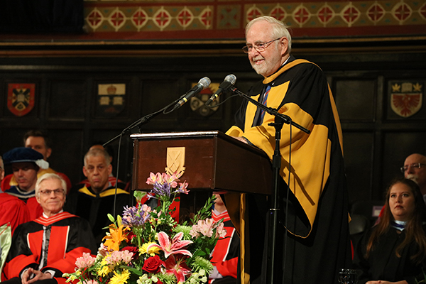 Nobel Laureate and Professor Emeritus Arthur McDonald speaks at Grant Hall after receiving an honorary degree from Queen's University on Wednesday morning. (Photo by Bernard Clark)