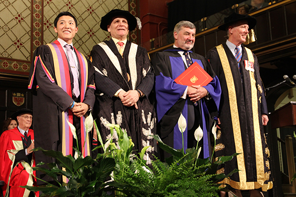 Lord John Alderdice, third from left, stands alongside Rector Cam Yung, Principal Daniel Woolf, and Chancellor Jim Leech, after receiving an honorary degree from Queen's University on Monday.