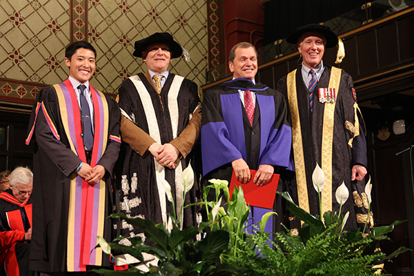 Frank McKenna, third from left, stands with Rector Cam Yung, Principal Daniel Woolf and Chancellor Jim Leech after receiving an honorary degree from Queen's University.