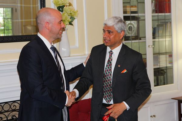Provost Benoit-Antoine Bacon and His Excellency Vikas Swarup shake hands at the University Club. (University Communications)