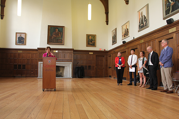 Ann Tierney, Vice-Provost and Dean of Student Affairs, welcomes Queen's students receiving major admission awards during a ceremony Monday at Wallace Hall. (University Communications)