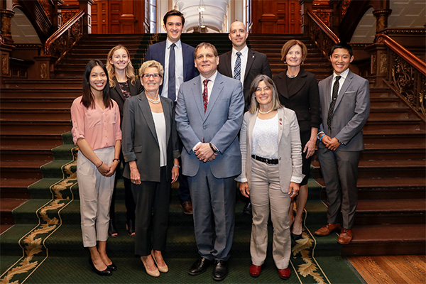 Premier Kathleen Wynne, front, second from left, and Kingston and the Islands MPP Sophie Kiwala, front right, met with a delegation from Queen's University. Front, from left: AMS President Jennifer Li; Premier Wynne; Principal Daniel Woolf; Ms. Kiwala. Back, from left: AMS Vice-President (Operations) Chelsea Hollidge; AMS Vice-President (University Affairs) Palmer Lockridge; Provost Benoit-Antoine Bacon; Vice-Provost and Dean of Student Affairs Ann Tierney; and Rector Cam Yung.