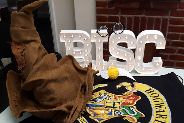 Some of the decor from Harry Potter Night, including the legendary 'Sorting Hat', some Potter-esque glasses, the Golden Snitch, and a flag. (Supplied Photo)