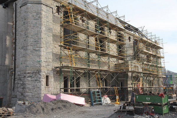 Repointing work is underway to touch up the limestone façade on the front of the IWC. (University Communications)