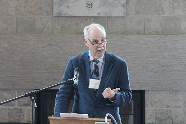 John Fisher, interim Vice-Principal (Research), welcomes guests to the celebration of research excellence, held in Stauffer Library's Alan G. Green Fireplace Reading Room. (University Communications)