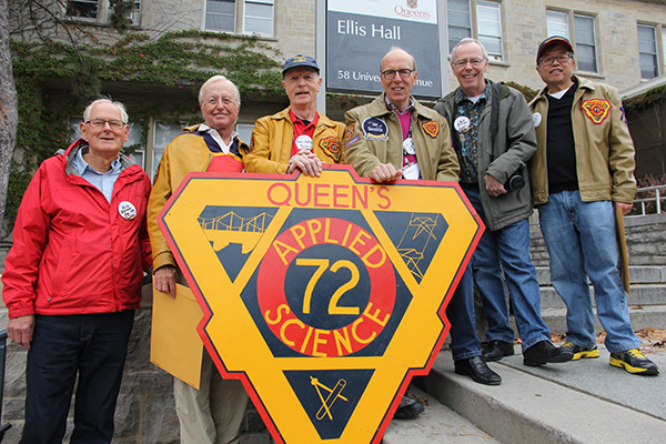 Members of Sc'72 line up behind their banner on Saturday morning along University Avenue, including Stephen J.R. Smith, fourth from left, a strong financial supporter of Queen's and its students. For his support, the university named the Smith School of Business in his honour. (University Communications)