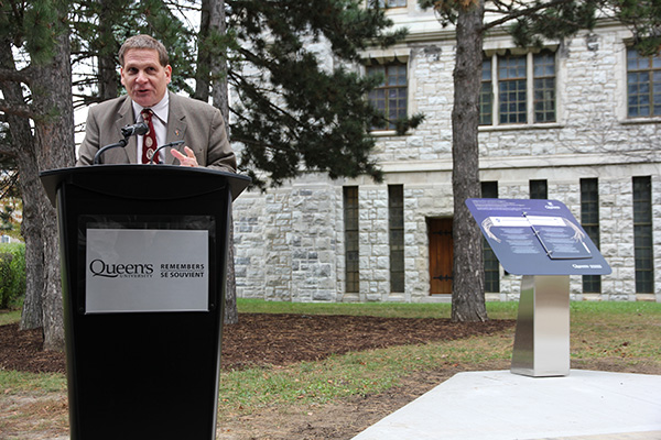 Principal Daniel Woolf speaks at the unveiling of the first Queen's Remembers plinth. These monuments are designed to help staff and faculty, students, and other visitors to the campus form a more complete picture of the history of Queen's. (University Communications)