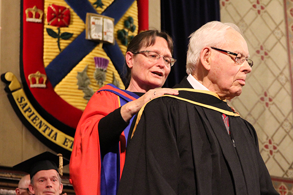 Bruce Jameson is hooded by Lynann Clapham, Associate Dean (Academic), Faculty of Engineering and Applied Science during Tuesday afternoon's Fall Convocation Ceremony.