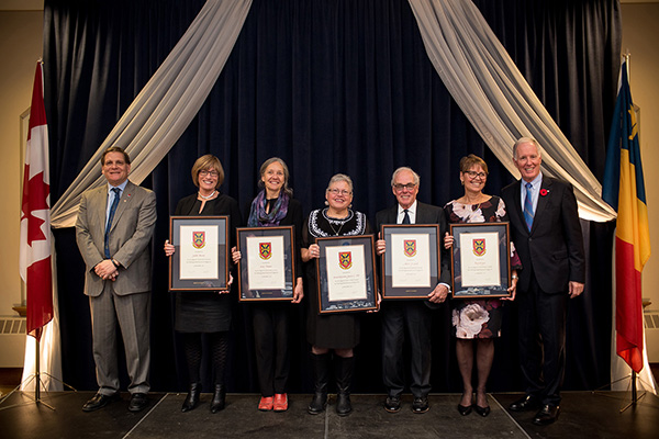Principal Daniel Woolf, left, and Chancellor Jim Leech, right, helped recognize Distinguished Service Award recipients Judith Brown, Irène Bujara, Kanonhsyonne (Janice Hill), Albert Clark and Terry Krupa, at the University Council Dinner on Saturday, Nov. 4.