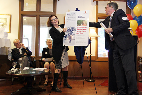The John Meisel Scholar Series in Contemporary Political Controversies was announced during his 94th birthday party at the University Club. Helping unveil the poster were, from left: Keith Banting (Political Studies, Smith School of Business); Barbara Crow, Dean of the Faculty of Arts and Science; Zsuzsa Csergő, Head, Department of Political Studies; and Tom Hewitt Chief Development Officer, Advancement.