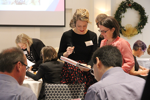 Attendees of the New Managers Orientation work together on a project during the event held Tuesday, Nov. 21 at the University Club.