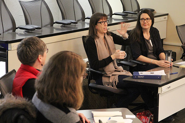 A Queen's faculty member speaks during one of the small group discussions at the Faculty Writing Retreat, held at the Donald Gordon Centre.