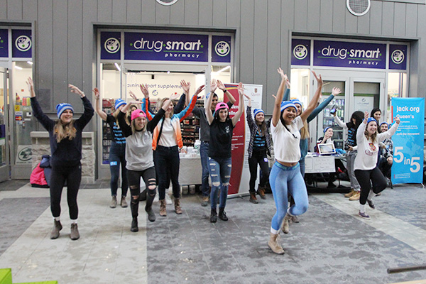 Queen's students take part in a flash mob at the Queen's Centre on Bell Let's Talk Day.