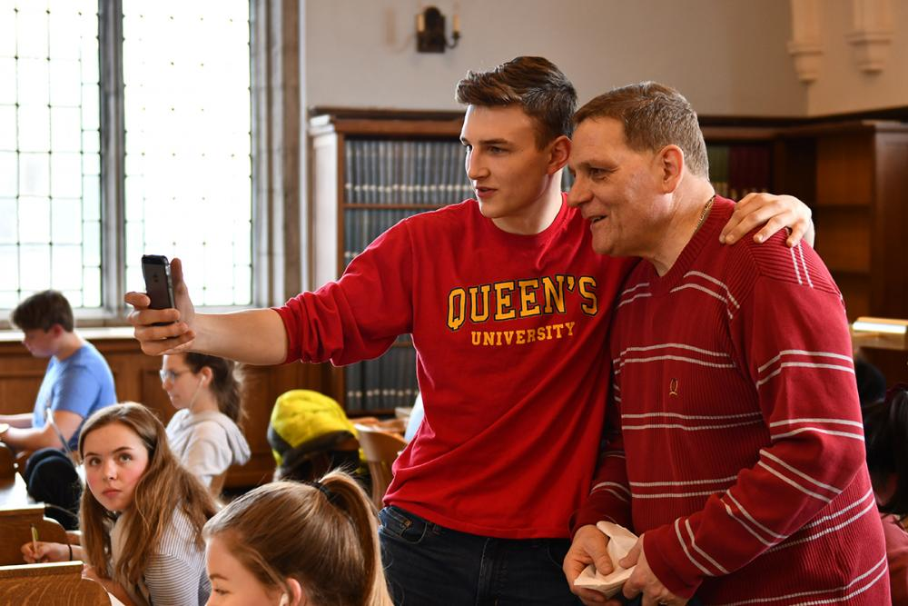 [Principal Daniel Woolf takes a selfie with student at Douglas Library]