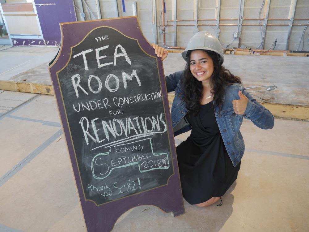 [Isabel Hazan (Sc'20), Head Manager of The Tea Room, updates the sign. (Photo: Queen's Alumni)]
