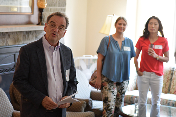 Interim Provost and Vice-Principal (Academic) Tom Harris speaks with recently-arrived faculty members during a special welcome event at the University Club. (University Communications)