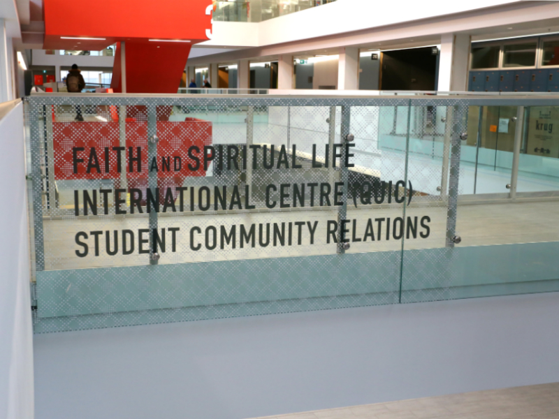 Mitchell Hall signage for QUIC, Faith and Spiritual Life, and Student Community Services