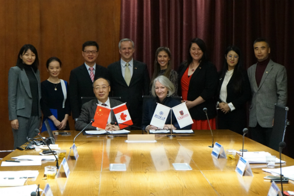 Representatives from both universities present at the November 2018 Beijing Normal University signing ceremony in China.