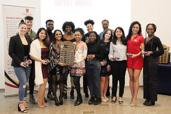 The executive of the African and Caribbean Students' Association (ACSA) accept the Equity, Diversity and Inclusivity Impact Award.